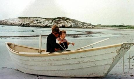 Kennedy gave his son, John, an early introduction to boats at Bailey's Beach in Newport, R.I., in September 1963.